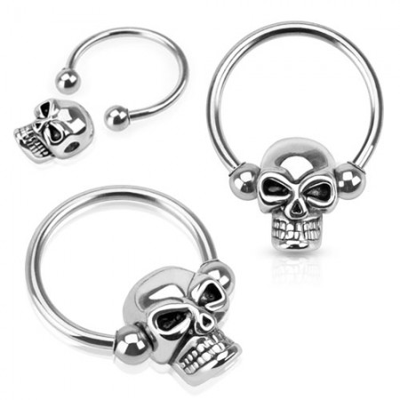 Ball closure ring with skull for ball