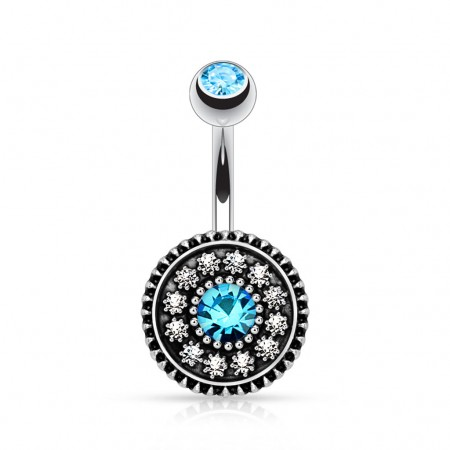 Belly piercing with light blue crystal on shield