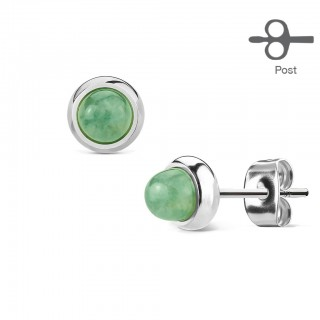 Pair ear lobe piercings with round gemstone