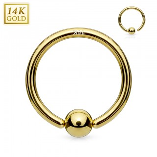 14 Kt. solid gold ball closure ring with attached ball