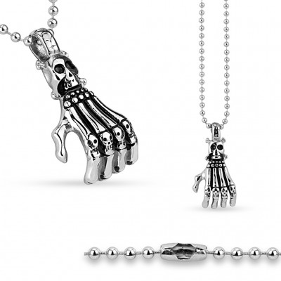 Necklace with hand beneath skull pendant