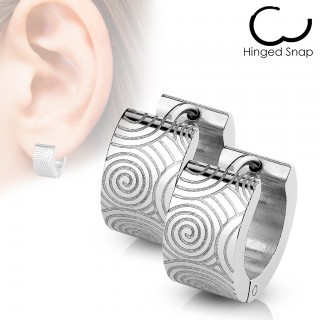 Pair of glossy steel earrings with grooved spirals