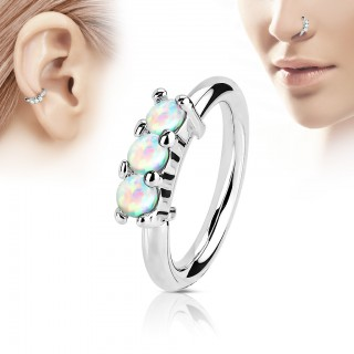 Multifunctional piercing ring with three white opal stones