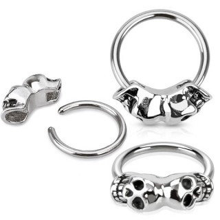 Ball closure ring met twee doodshoofden