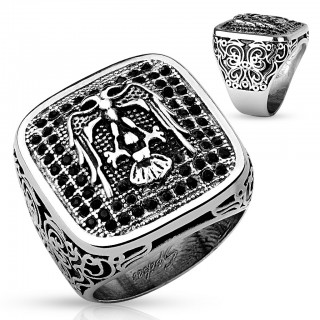 Ring with eagle and small black gemstones