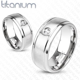 Solid titanium ring with CZ and brushed metal centre