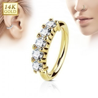 Piercing ring of solid gold with five clear diamonds