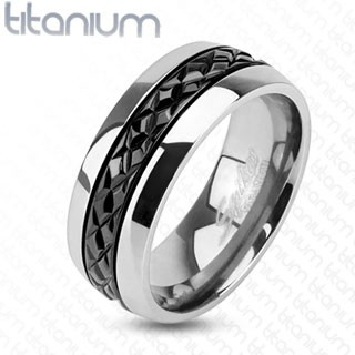 Solid titanium ring with grooved black centre