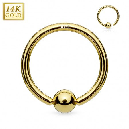 Gold 14 kt. captive bead ring with attached ball