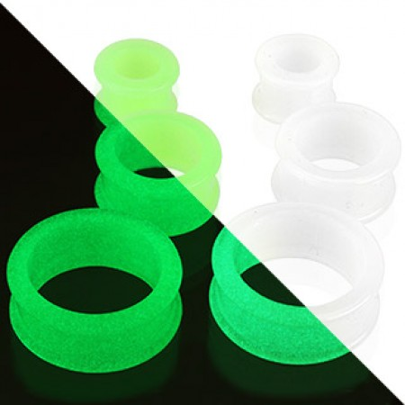 Glow in the dark ear tunnels of flexible silicone