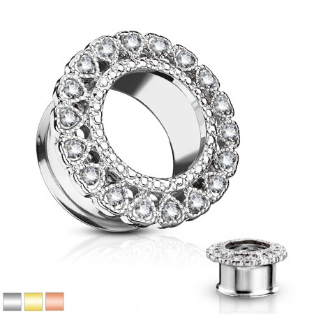 Double flared tunnel with heart shaped crystal on rim