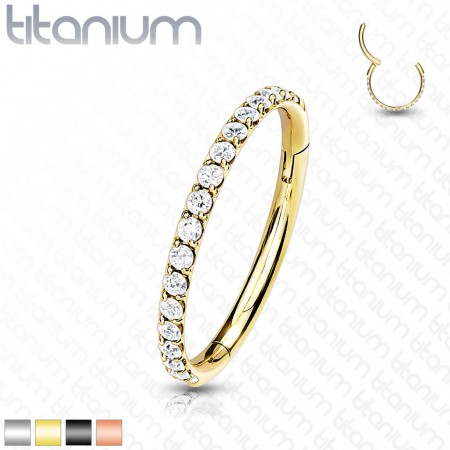 Titanium piercing ring with attached segment and clear crystals