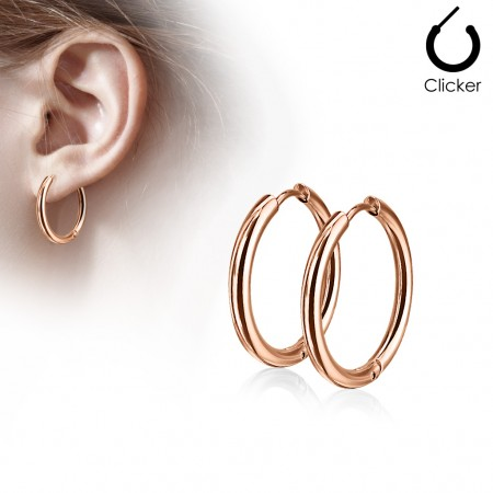 Pair of rose gold coloured earrings with hinge action