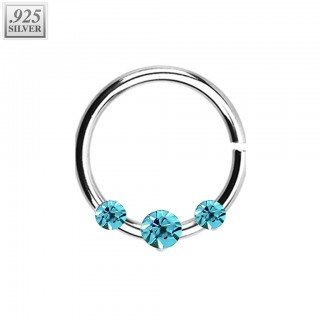 Piercing ring of .925 sterling silver with prong set crystals