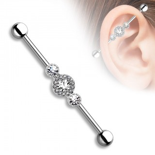 Tri-crystal industrial barbell piercing surrounded with smaller gems