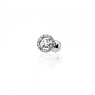 Cartilage piercing with crystal surrounded by gemmed halo