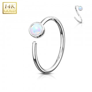 Solid gold nose ring piercing with bezel set opal