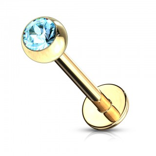 Gold labret piercing with gem ball