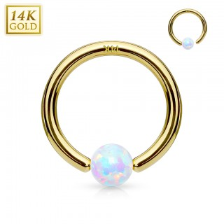 Solid gold ball closure ring with fixed opal ball