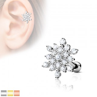 Ear piercing with top of a clear snow flake