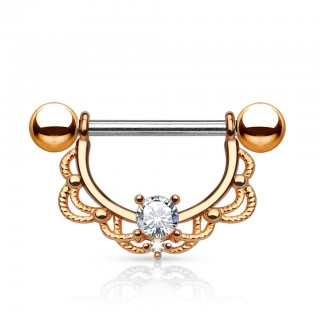 Golden nipple bar with clear gem encased in shield