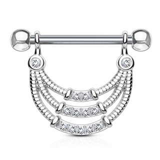 Nipple piercing with trio of dangling bands and white jewels
