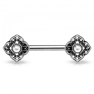 Tribal style flowered nipple piercing with coloured gems