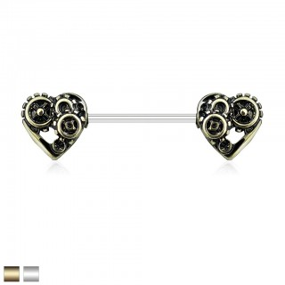 Nipple piercing with mechanic hearts in antique colours