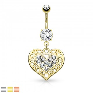 Belly button piercing with heart shaped dangle