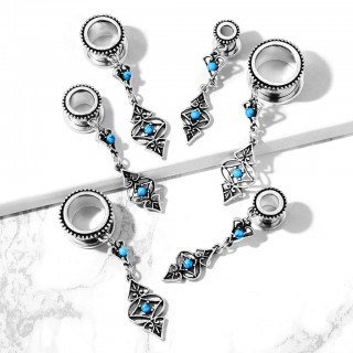 Tunnel piercing with dangling turquoise tribal charms