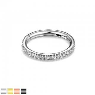 Coloured piercing ring with attached segment and clear crystals