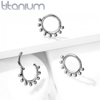 Titanium piercing ring with attached segment and outer beads