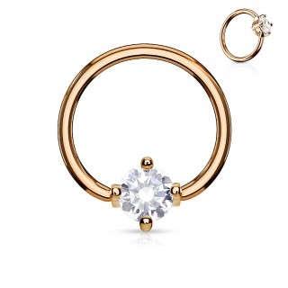 Coloured piercing ring with prong set round crystal