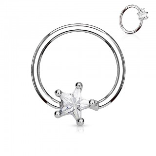Coloured piercing ring with star shaped diamond