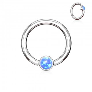 Ball closure ring with opal gem in cylinder