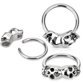 Ball closure ring with two skulls