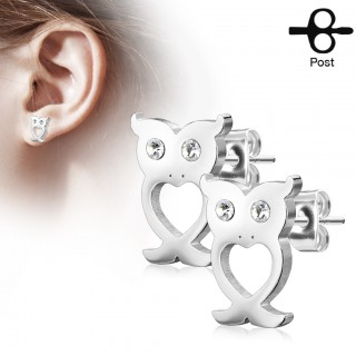 Crystal adorned owl shaped ear piercings
